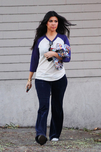 Kourtney Kardashian wallpaper possibly with long trousers, a pantleg, and a hip boot titled Kourtney Kardashian in LA