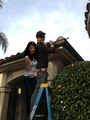 Selena/David hanging Christmas lights!