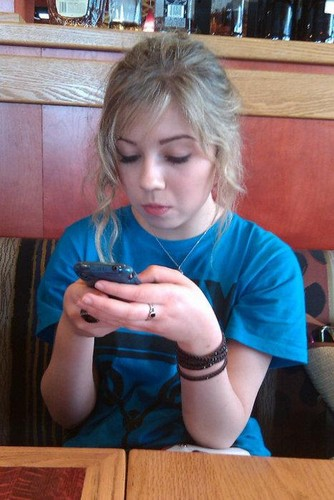 Jennette and her iphone