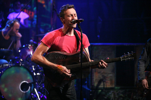 Coldplay wallpaper with a guitarist and a concerto entitled On Stage: Late Night With Jimmy Fallon [December 7, 2011]