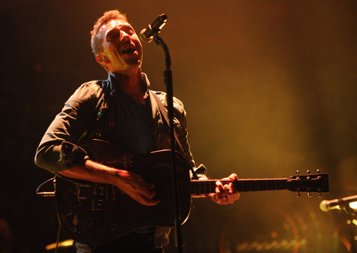 Coldplay wallpaper containing a concerto and a guitarist titled On Stage: Under 1 Roof [December 10, 2011]