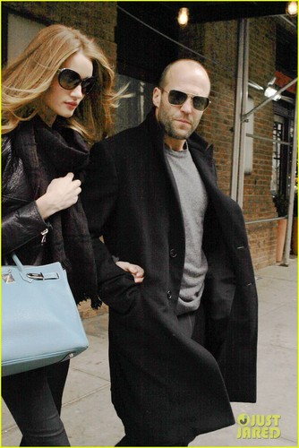 Jason Statham Hintergrund containing sunglasses, a business suit, and a well dressed person called Rosie Huntington-Whiteley & Jason Statham: NYC Stroll!