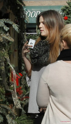 Khloe Kardashian wallpaper possibly containing a street and a camellia titled  Khloe gets a Christmas tree at the North Pole in Dallas - 20/12/2011