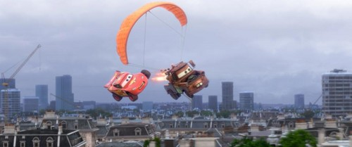 Disney Pixar Cars 2 Hintergrund with a business district entitled Cars flying