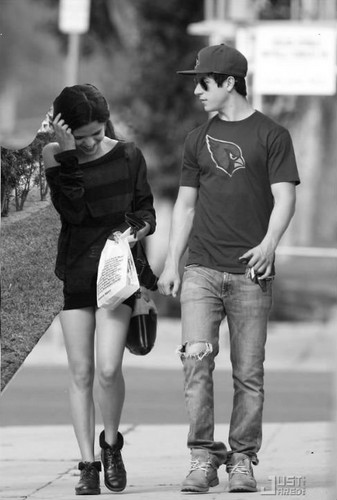 Manip: David and Selena walking on sidewalk