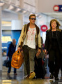 December 30: Walking at LAX Airport to fly to New York - ryan-gosling photo