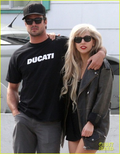 Lady Gaga wallpaper probably containing sunglasses and a leisure wear titled Lady Gaga & Taylor Kinney: PDA!