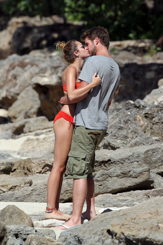 Miley Cyrus wallpaper titled Miley - 29. December - On a beach with Liam Hemsworth in Hawaii
