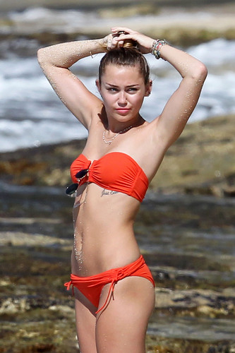 miley cyrus wallpaper with a bikini entitled Miley - 29. December - On a pantai with Liam Hemsworth in Hawaii