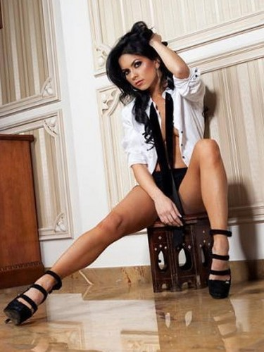 Inna wallpaper with bare legs, a hip boot, and a playsuit entitled Inna
