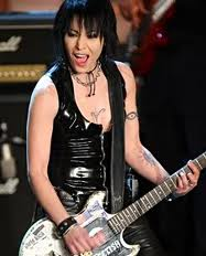 Joan Jett wallpaper possibly with a guitarist and a concert titled Joan Jett