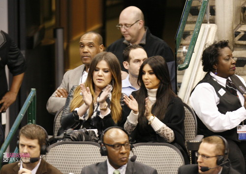 Khloe Kardashian wallpaper possibly containing a business suit, a brasserie, and a portrait entitled Kim and Khloe at the Dallas Mav. Game - 01/04/12