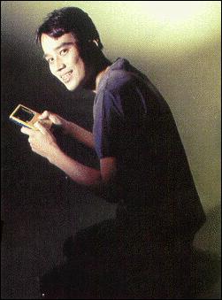 Satoshi Tajiri with a Gameboy