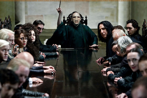 Bellatrix and Voldemort with Death Eaters