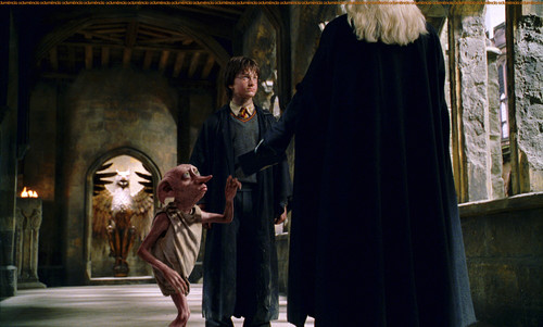 Lucius Malfoy with Harry Potter and Dobby