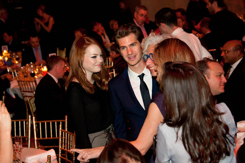Andrew Garfield and Emma Stone wallpaper possibly with a brasserie, a bistro, and a dinner table titled 7th Annual Worldwide Orphans Foundation's Benefit