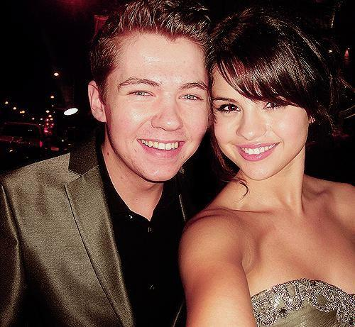 Damian McGinty wallpaper probably containing attractiveness and a portrait titled Damian McGinty & Selena Gomez