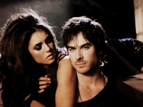 Elena Gilbert wallpaper with a portrait entitled Elena & Damon..!
