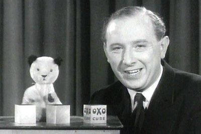 Sooty Zeigen Hintergrund probably containing a business suit titled Harry Corbett With Sooty
