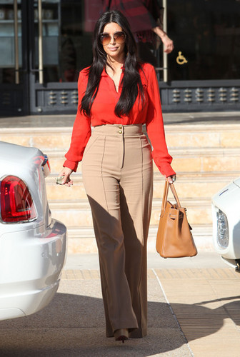 Kim Kardashian wallpaper containing a business suit and a well dressed person called Kim Kardashian Hits Barneys New York In Style