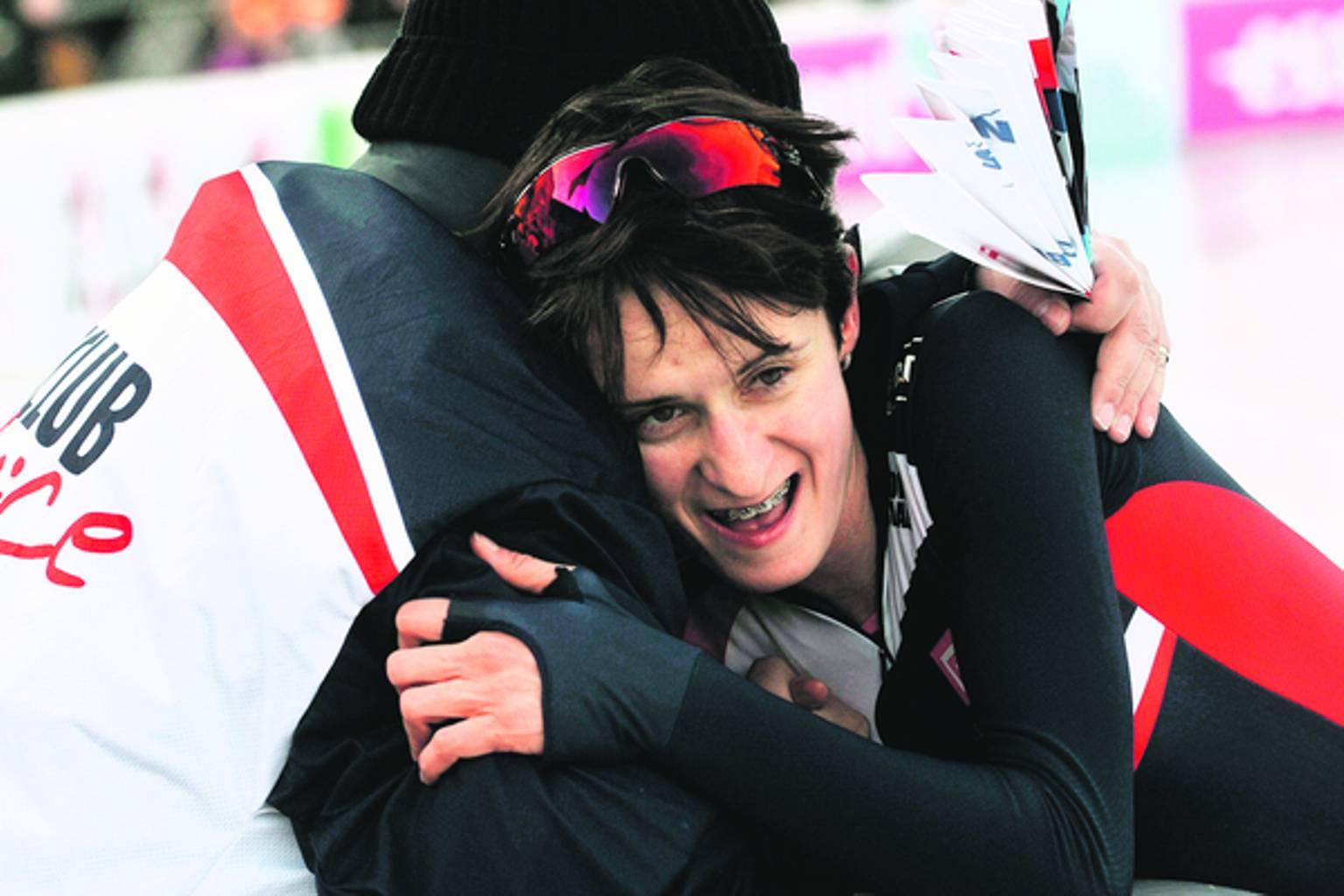 Novak embrace Sablikova 2012