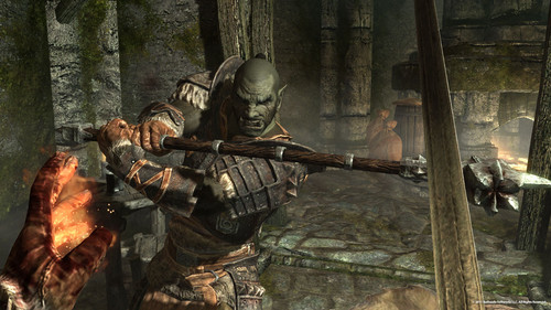 Elder Scrolls V : Skyrim wallpaper probably containing a fire and a rifleman called Orc