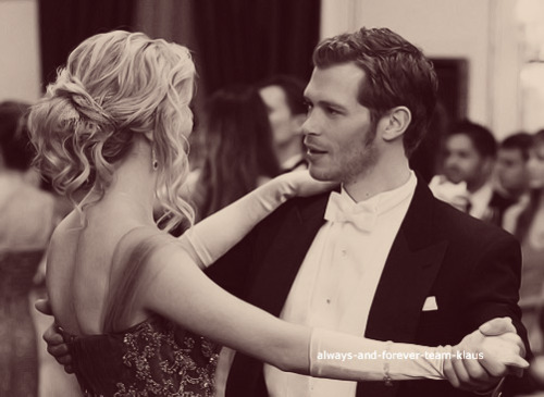 The Vampire Diaries Couples wallpaper probably containing a bouquet and a business suit titled klaus & caroline♥