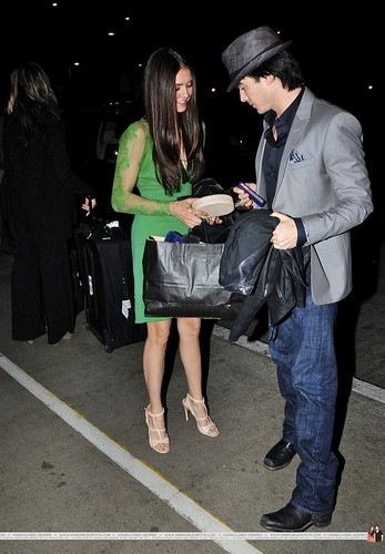 Ian Somerhalder and Nina Dobrev wallpaper containing a business suit entitled more Ian/Nina airport pics. ♥