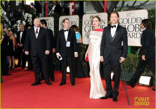 Angelina Jolie wallpaper with a business suit, a suit, and a dress suit titled Angelina Jolie: Golden Globes with Brad Pitt!