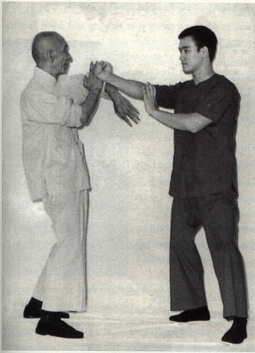 Bruce Lee wallpaper containing a business suit called Bruce with Yip man