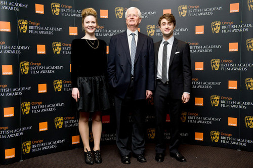 Daniel Radcliffe attend the nomination announcement for The arancia, arancio BAFTA