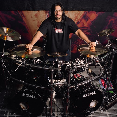 Fear Factory Hintergrund with a drummer, a snare drum, and a tenor drum entitled Raymond Herrera