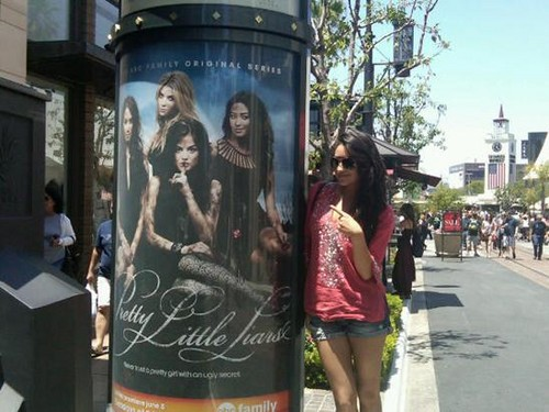 Shay posing with her poster