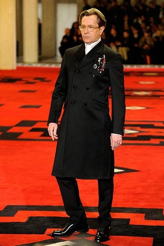 Gary Oldman walks the piste for Prada