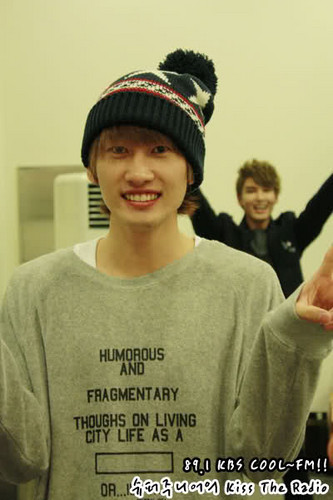 Lee Hyukjae / Lee Eunhyuk پیپر وال probably containing a leisure wear, an outerwear, and a sign entitled Eunhyuk & Ryeowook ^^