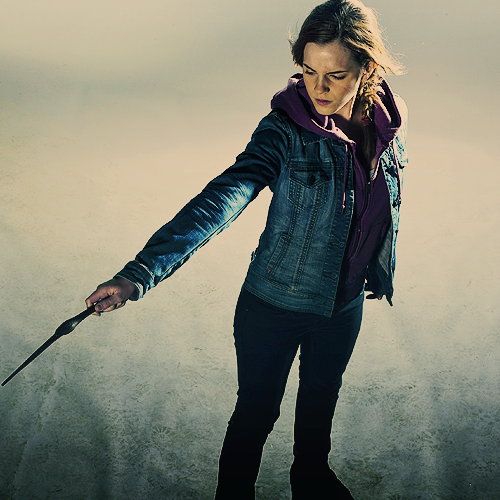 Hermione Granger wallpaper probably with an outerwear, a hip boot, and a box coat titled Harry Potter and the Deathly Hallows Part II  Photoshoot