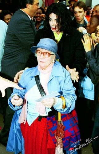 This elderly lady was knocked down da a crowd of fans, MJ helped her up and gave her ride home.