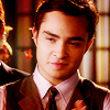 Ed Westwick photo probably with a business suit and a portrait entitled Ed
