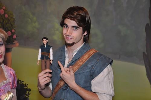 Eugene holding a doll of himself