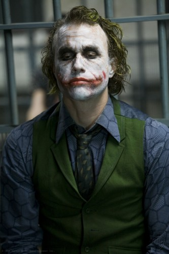 The Joker kertas dinding possibly with a business suit entitled the joker
