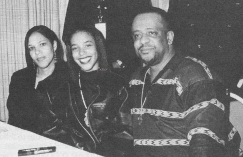 Aaliyah wallpaper probably containing a sign and a newspaper called Aaliyah with her parents *rare*