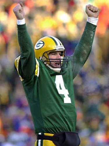 Brett Favre wallpaper probably with a lineman, a punter, and a tailback titled Brett Favre