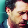 Dr. Gregory House photo with a business suit and a portrait entitled House