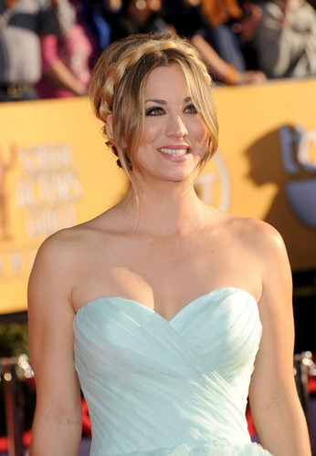 Kaley Cuoco wallpaper probably containing a dinner dress, a strapless, and a gown titled Kaley Cuoco @ the 18th Annual Screen Actors Guild Awards