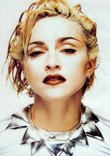 Madonna,Modelling for jean paul gaultier (what she wears in the blond ambition tour)