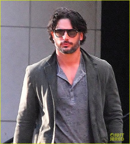 Joe Manganiello achtergrond possibly containing a business suit, a well dressed person, and sunglasses titled Joe Manganiello: Matt Bomer 'Would Make A Great Vampire'