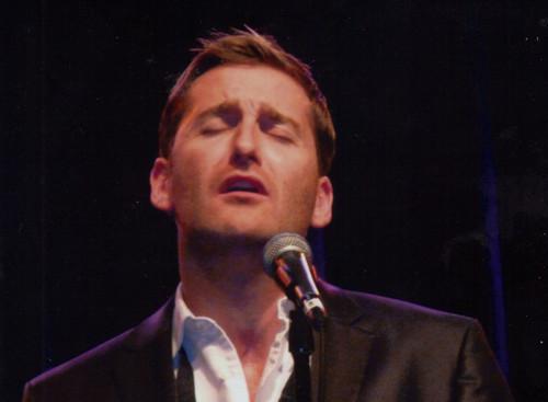 Paul singing at his Portland toon