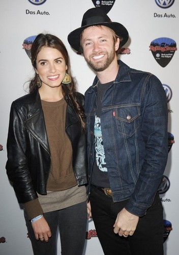 Nikki Reed wallpaper possibly with a hip boot, a fedora, and an outerwear titled Rolling Stone Hosts Volkswagen Rock & Roll Super Bowl Fan Tailgate Party.