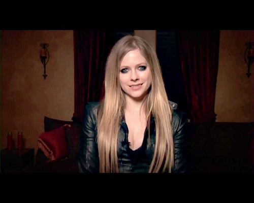 Avril Lavigne Hintergrund possibly containing a pianist and a portrait titled Avril Lavigne
