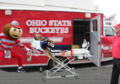 Brutus wheels injured Penn ST player. - ohio-state-football photo